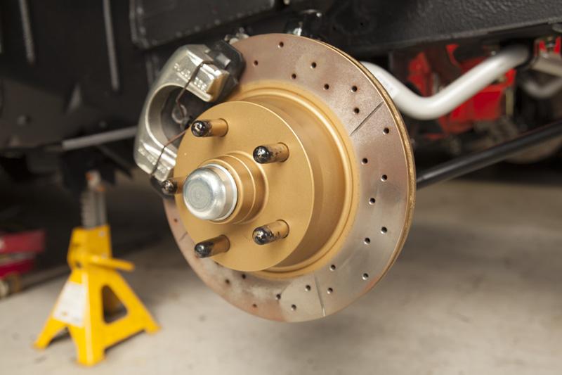 close up of golden coloured disc brake