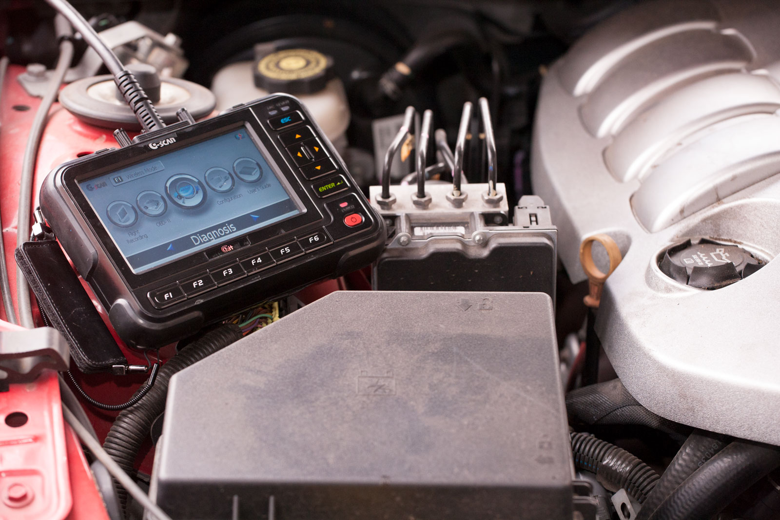 diagnostic tool resting in engine bay
